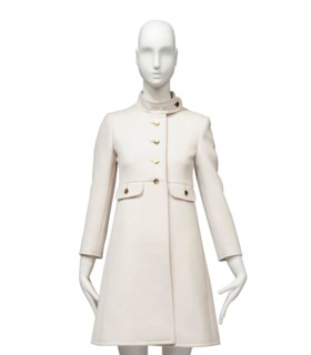 AN IVORY WOOL GABARDINE COAT TOGETHER WITH A PAIR OF SHOES