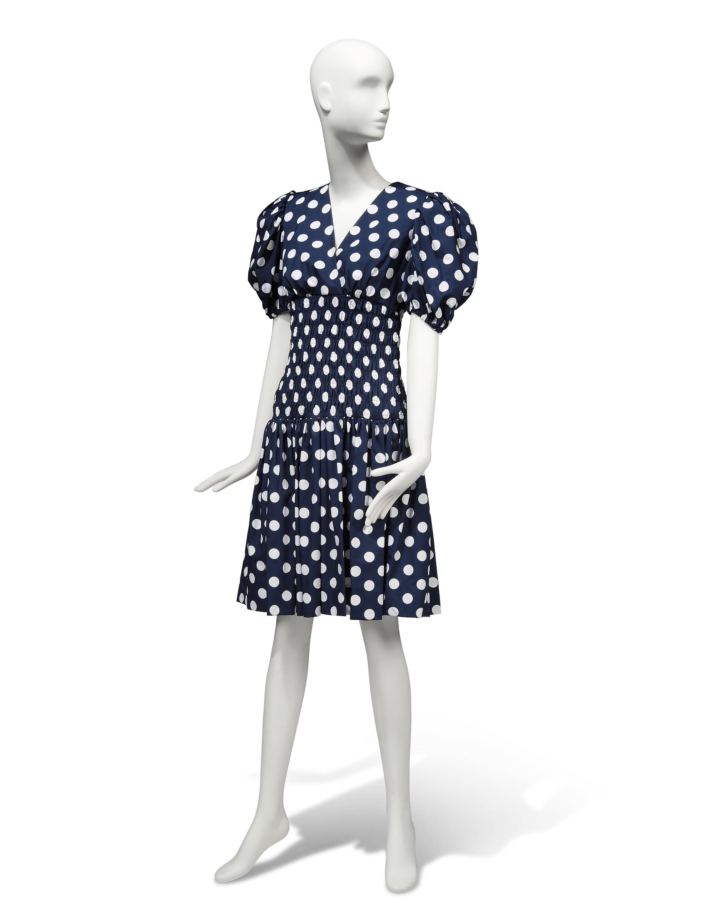 A NAVY AND WHITE POLKADOT COTTON SUMMER DRESS