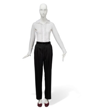 A RUFFLED WHITE SHIRT, BLACK STRIPED WOOL TROUSERS AND A PAI