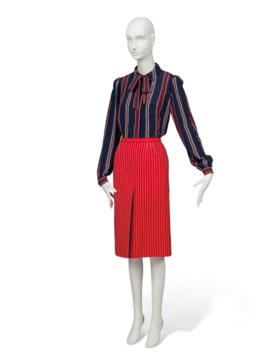 A RED WOOL PINSTRIPED SKIRT, A SILK BLOUSE AND TIE AND ANOTH