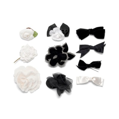 A COLLECTION OF BLACK AND WHITE SILK FLOWERS, BOWS AND RIBBONS