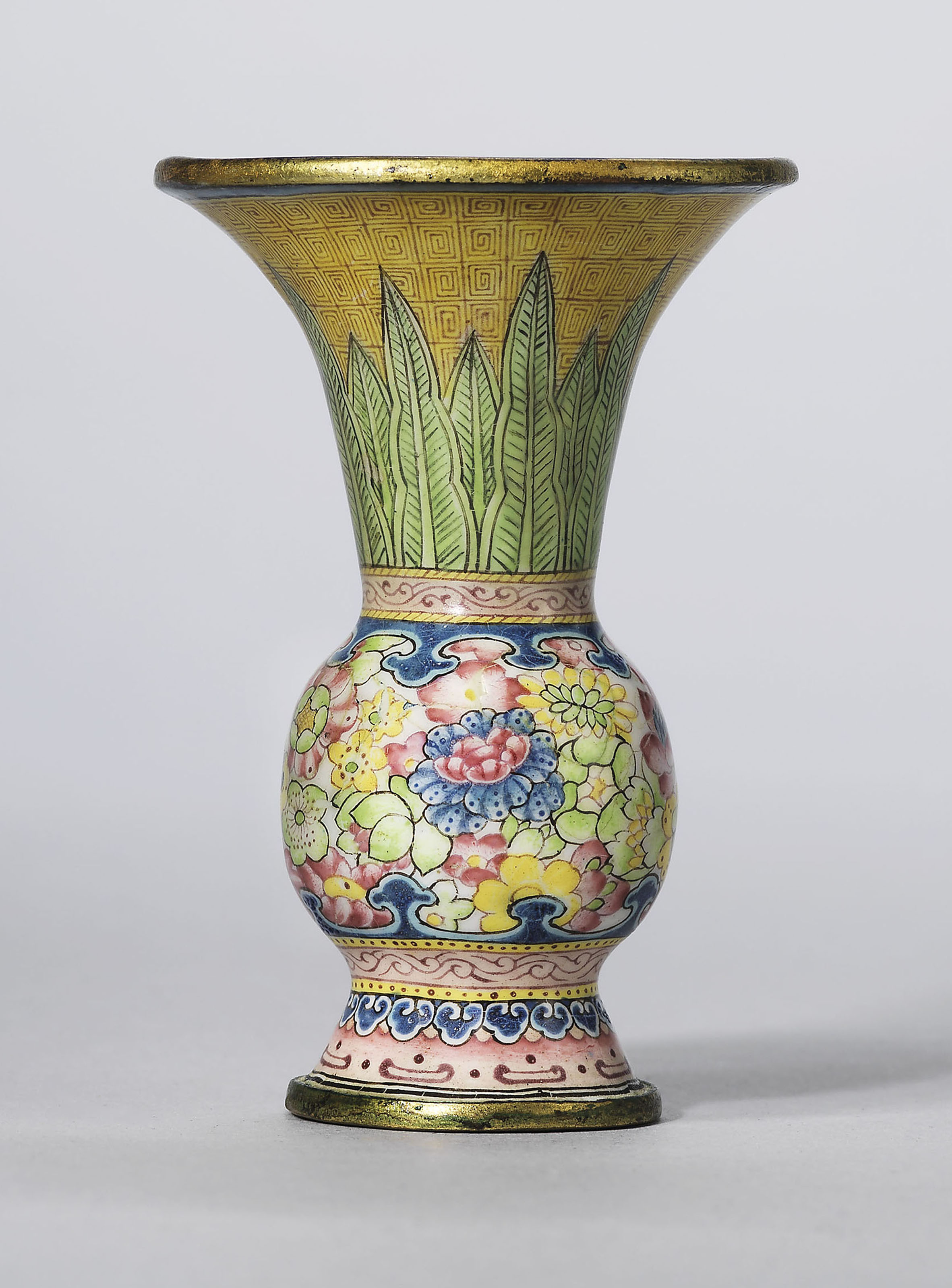 A rare painted enamel gu-shaped miniature vase, Qianlong four-character mark in blue enamel and of the period (1736-1795). 2½  in (6.4  cm) high. Estimate £30,000-50,000. Offered in Rarity and Refinement Treasures from a Distinguished East Asian Collection on 15 May at Christie's in London