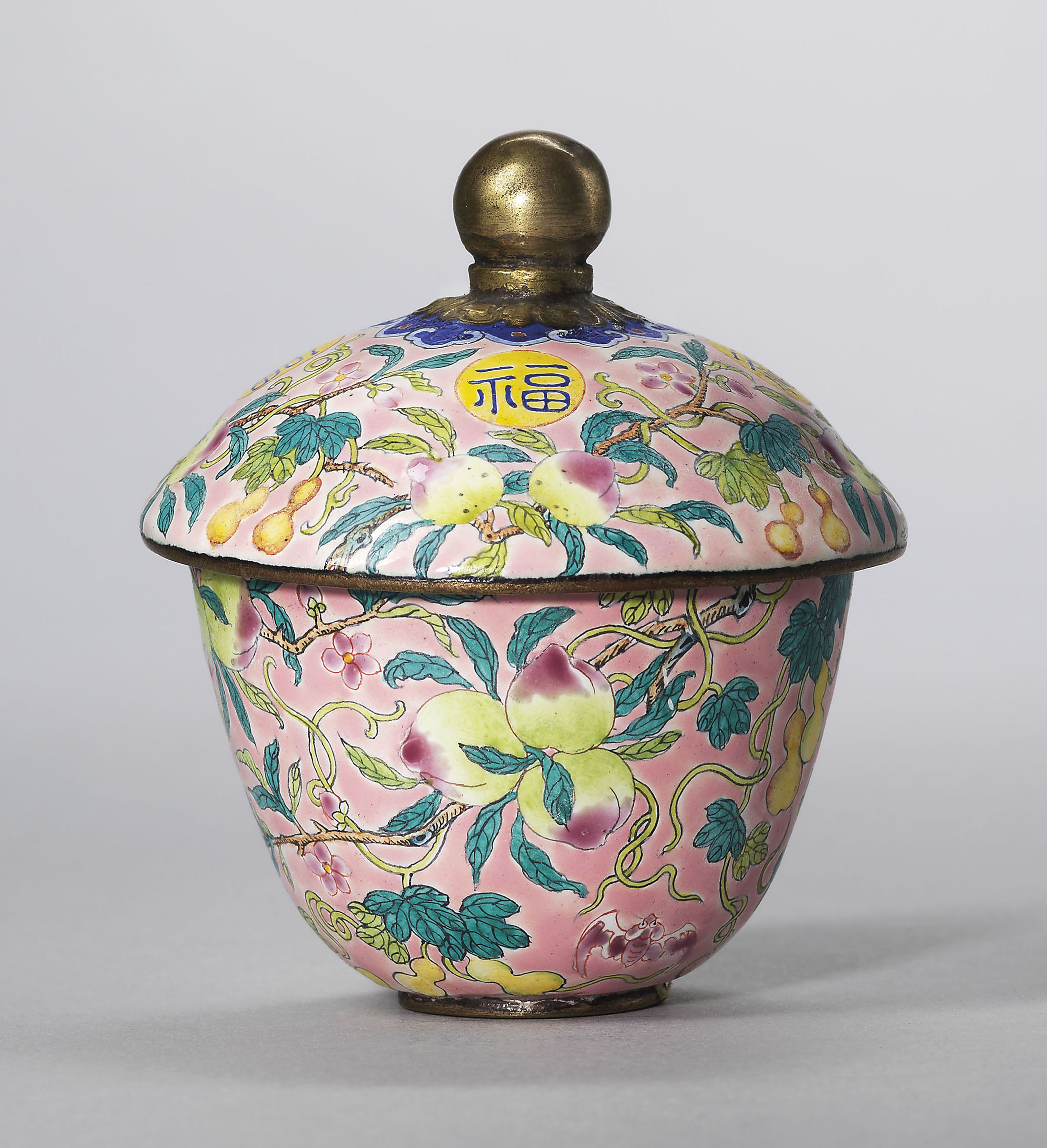 A FAMILLE ROSE PINK-GROUND PAINTED ENAMEL CUP AND COVER