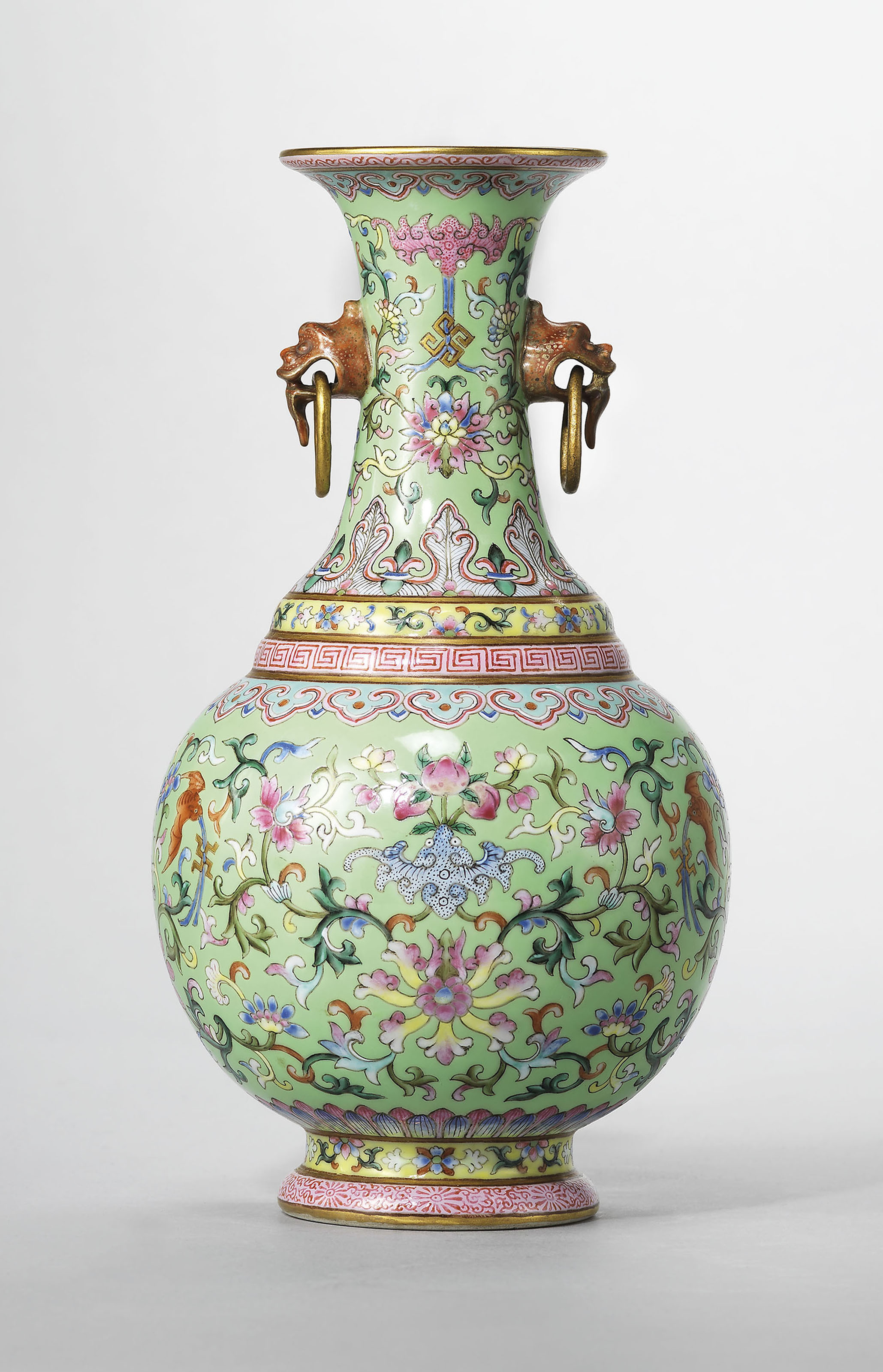 A lime-green ground famille rose twin-handled vase, Jiaqing six-character sealmark in iron-red and of the period (1796-1820). 7¾  in (19.8  cm) high. Estimate £80,000-120,000. Offered in Rarity and Refinement Treasures from a Distinguished East Asian Collection on 15 May at Christie's in London