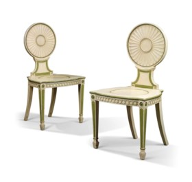 A PAIR OF GEORGE III WHITE AND GREEN-PAINTED HALL CHAIRS