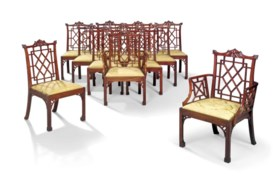 A SET OF TWELVE MAHOGANY DINING-CHAIRS 'IN THE CHINESE MANNE