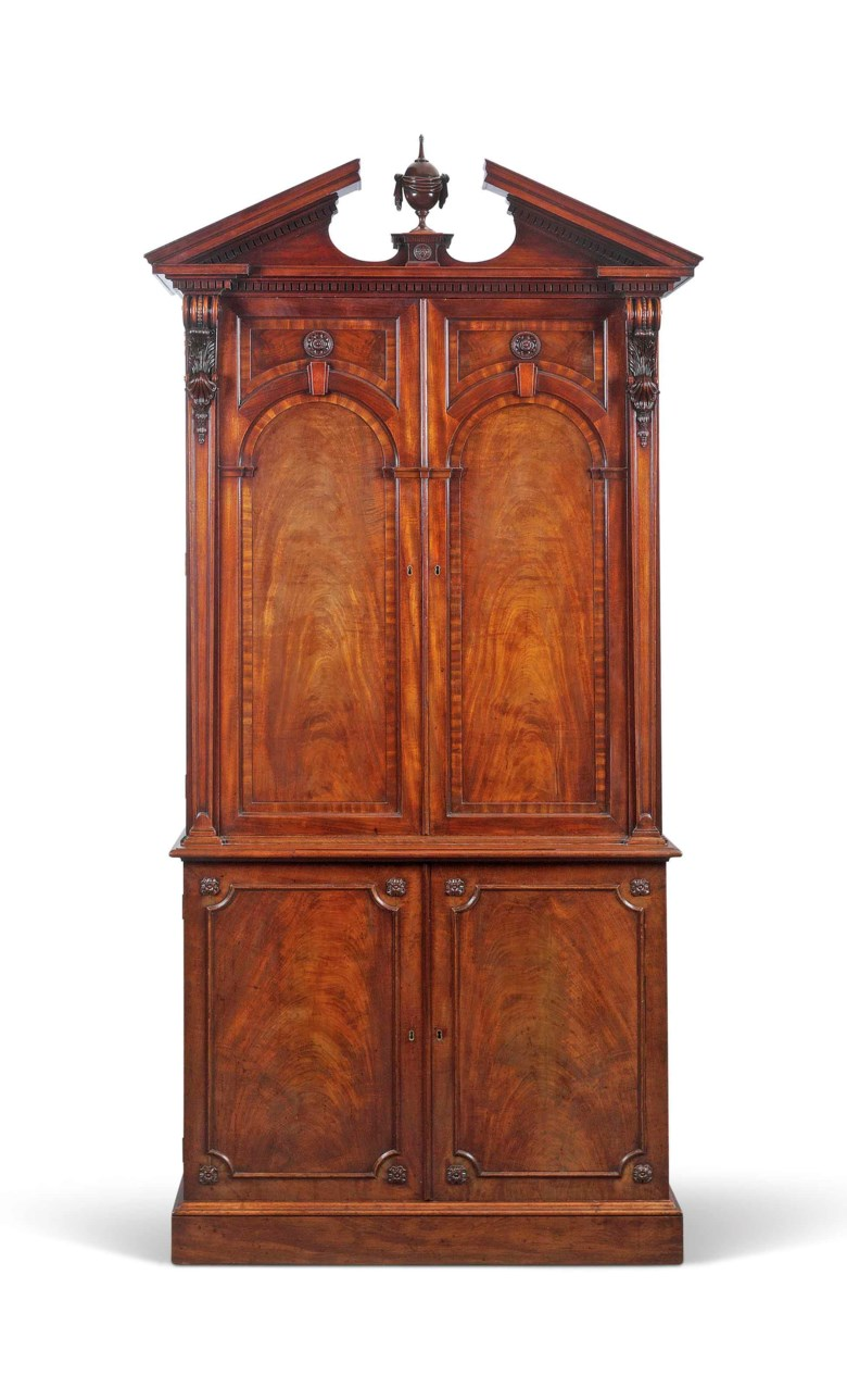 A George III mahogany cabinet, by Thomas Chippendale, circa 1770. 99½  in (253  cm) high, including finial; 47½  in (121  cm) wide; 20  in (51  cm) deep. Estimate £300,000-500,000. Offered in Thomas Chippendale 300 Years on 5 July 2018 at Christie's in London