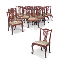 A SET OF FOURTEEN MAHOGANY DINING-CHAIRS AFTER A DESIGN BY THOMAS CHIPPENDALE