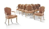 A SET OF TWELVE GEORGE III PARCEL-GILT AND WHITE-PAINTED ARMCHAIRS