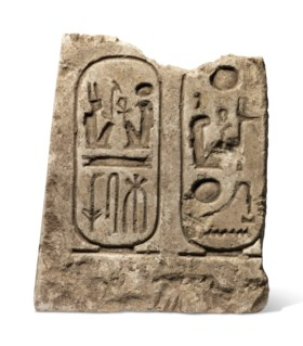 AN EGYPTIAN LIMESTONE RELIEF WITH CARTOUCHES FOR RAMSESSES I