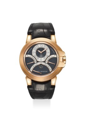 HARRY WINSTON AN EXTREMELY FINE 18K ROSE GOLD TRIPLE RETROGRADE CHRONOGRAPH AUTO