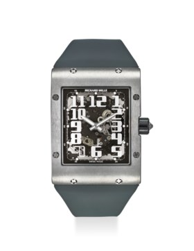 RICHARD MILLE AN EXTREMELY FINE TITANIUM EXTRA FLAT WRISTWATCH WITH DATE, ORIGIN