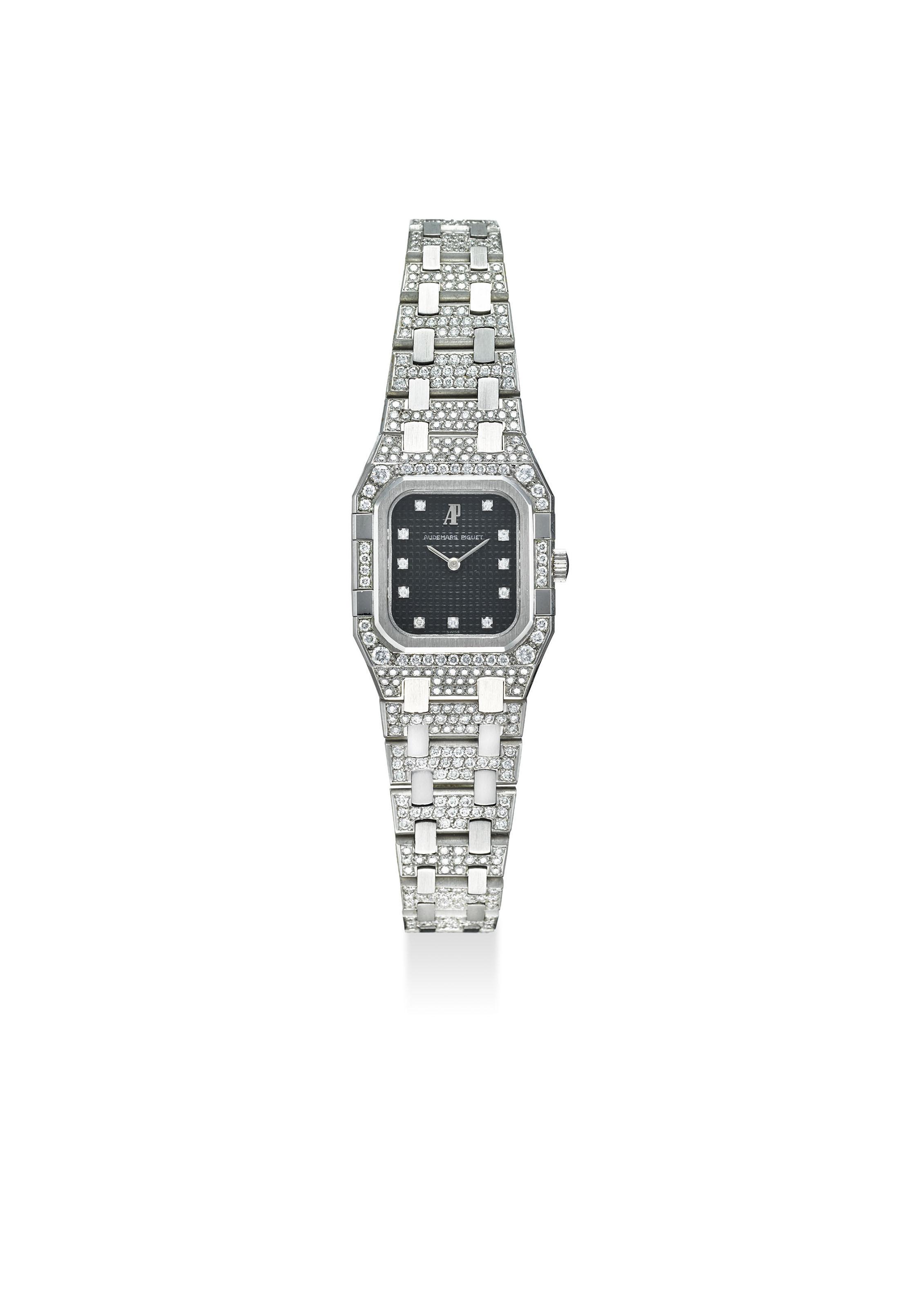 Audemars piguet an 18k white gold and diamond set octagonal quartz wristwatch with bracelet for Audemars piguet kinetic