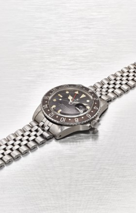 ROLEX A STAINLESS STEEL AUTOMATIC DUAL TIME WRISTWATCH WITH