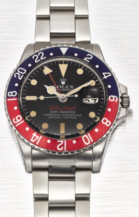 ROLEX A VERY FINE AND EXTREMELY RARE STAINLESS STEEL DUAL TI