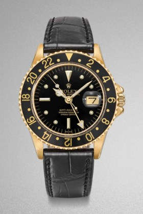 Rolex A fine 18K gold automatic two time-zone time wristwatc