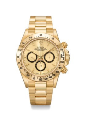 Rolex A rare and attractive 18K gold automatic chronograph w