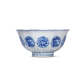 A RARE MING-STYLE BLUE AND WHITE FLORAL-FORM BOWL