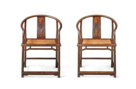 A VERY RARE PAIR OF ZITAN CONTINUOUS HORSESHOE-BACK ARMCHAIR
