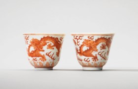 TWO IRON-RED DECORATED 'DRAGON' WINE CUPS