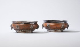 A PAIR OF TIBETAN SILVER-MOUNTED WOOD OFFERING BOWLS