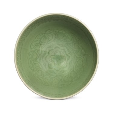 A rare carved Longquan celadon bowl, lianzi wan, Yongle-Xuande period (1403-1435). 6⅜  in (16.2  cm)  diam, box. Estimate HK$2,000,000-3,000,000. This lot is offered in Important Chinese Ceramics and Works of Art on 28 November 2018 at Christie's in Hong Kong
