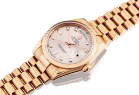 ROLEX A FINE 18K PINK GOLD AND DIAMOND-SET AUTOMATIC WRISTWA