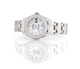 ROLEX A LADY'S FINE 18K WHITE GOLD AND DIAMOND-SET AUTOMATIC