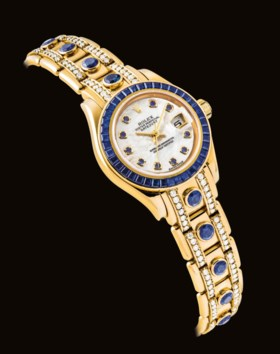 ROLEX A LADY'S FINE AND RARE 18K GOLD, DIAMOND AND SAPPHIRE-