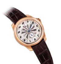 LUDOVIC BALLOUARD. A VERY FINE, VERY RARE AND UNUSUAL 18K PINK GOLD LIMITED EDITION WRISTWATCH WITH MOTHER-OF-PEARL DIAL