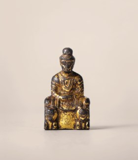 A RARE EARLY GILT-BRONZE FIGURE OF SAKYAMUNI