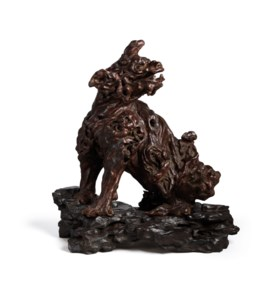 AN EXTREMELY RARE ALOESWOOD FIGURE OF QILIN AND EBONY STAND