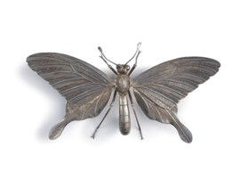 A silver articulated sculpture of a butterfly