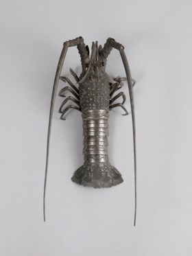 A silver articulated sculpture of a lobster