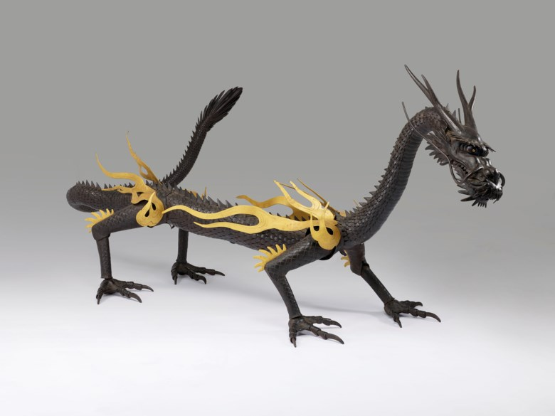 An important iron articulated sculpture of a dragon, Meiji-Taisho period (early 20th century), signed Muneyoshi  (Tanaka Tadayoshi -1958). 118⅛  in (300  cm) long. Estimate HK$6,500,000-9,500,000. This lot is offered in The Meiji Aesthetic Selected Masterpieces from a Private Asian Collection on 27 November 2018 at Christie's in Hong Kong