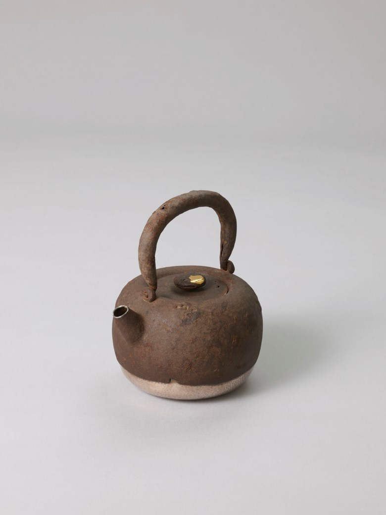 A silver kettle wrapped in iron, Meiji period (Late 19th century), sealed Sobi (Yamada Sobi; 1871-1916). 5⅝  in (14.3  cm) wide. Estimate HK$650,000-950,000. This lot is offered in The Meiji Aesthetic Selected Masterpieces from a Private Asian Collection on 27 November 2018 at Christie's in Hong Kong