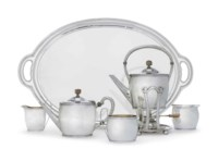 AN AMERICAN SILVER FIVE-PIECE TEA SERVICE AND MATCHING TRAY