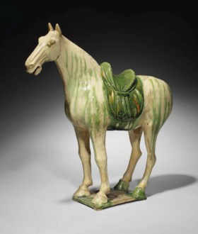 A LARGE SANCAI-GLAZED POTTERY FIGURE OF A HORSE