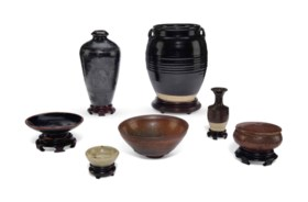 A GROUP OF BROWN-GLAZED VESSELS