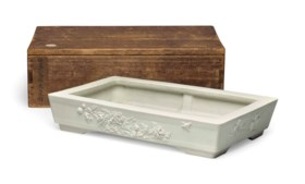 A CARVED BISCUIT RECTANGULAR BASIN