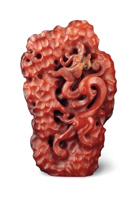 AN AMBER 'MOUNTAIN' CARVING