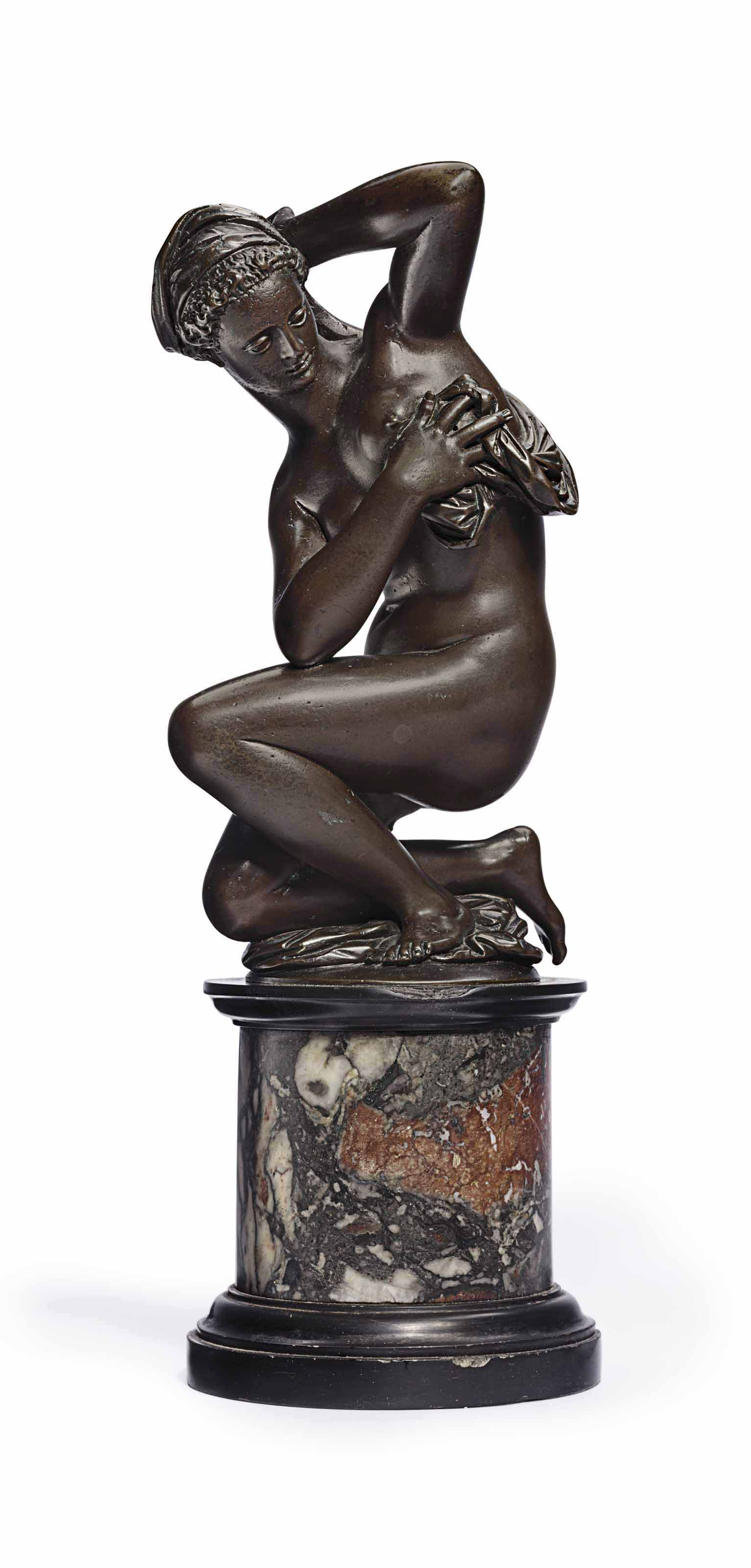 A BRONZE FIGURE OF A WOMAN BATHING