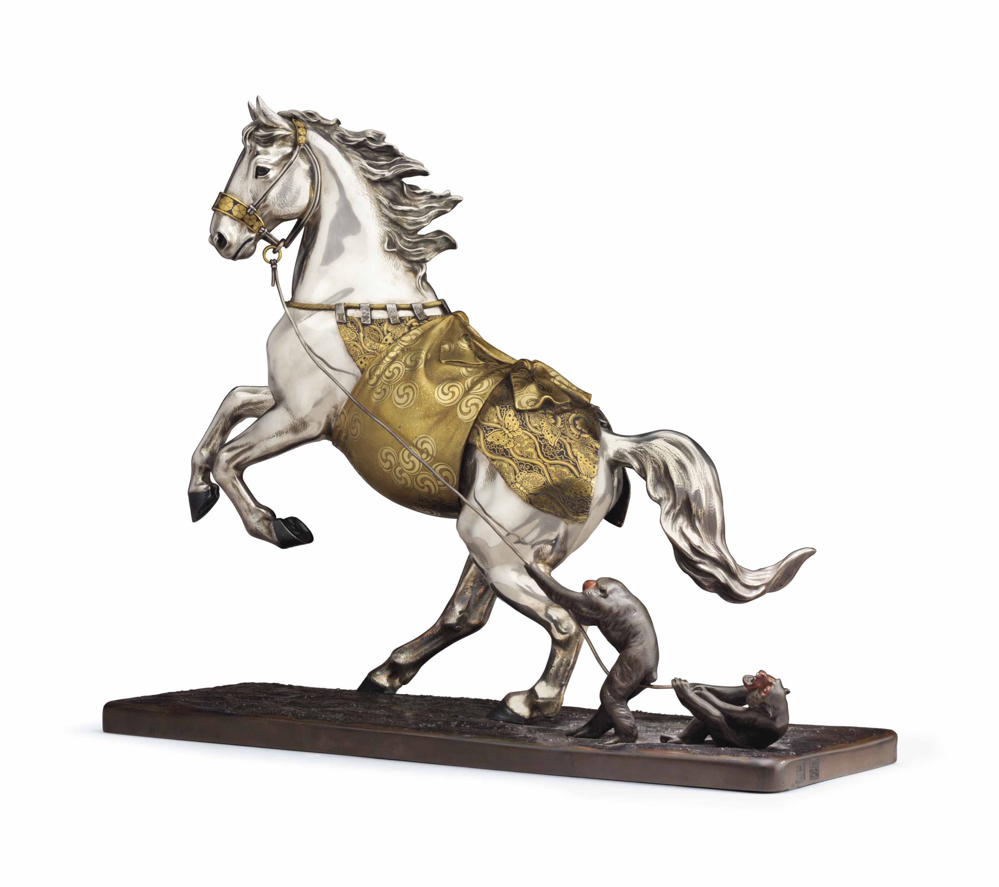 A PATINATED BRONZE MODEL OF A REARING HORSE AND MONKEYS