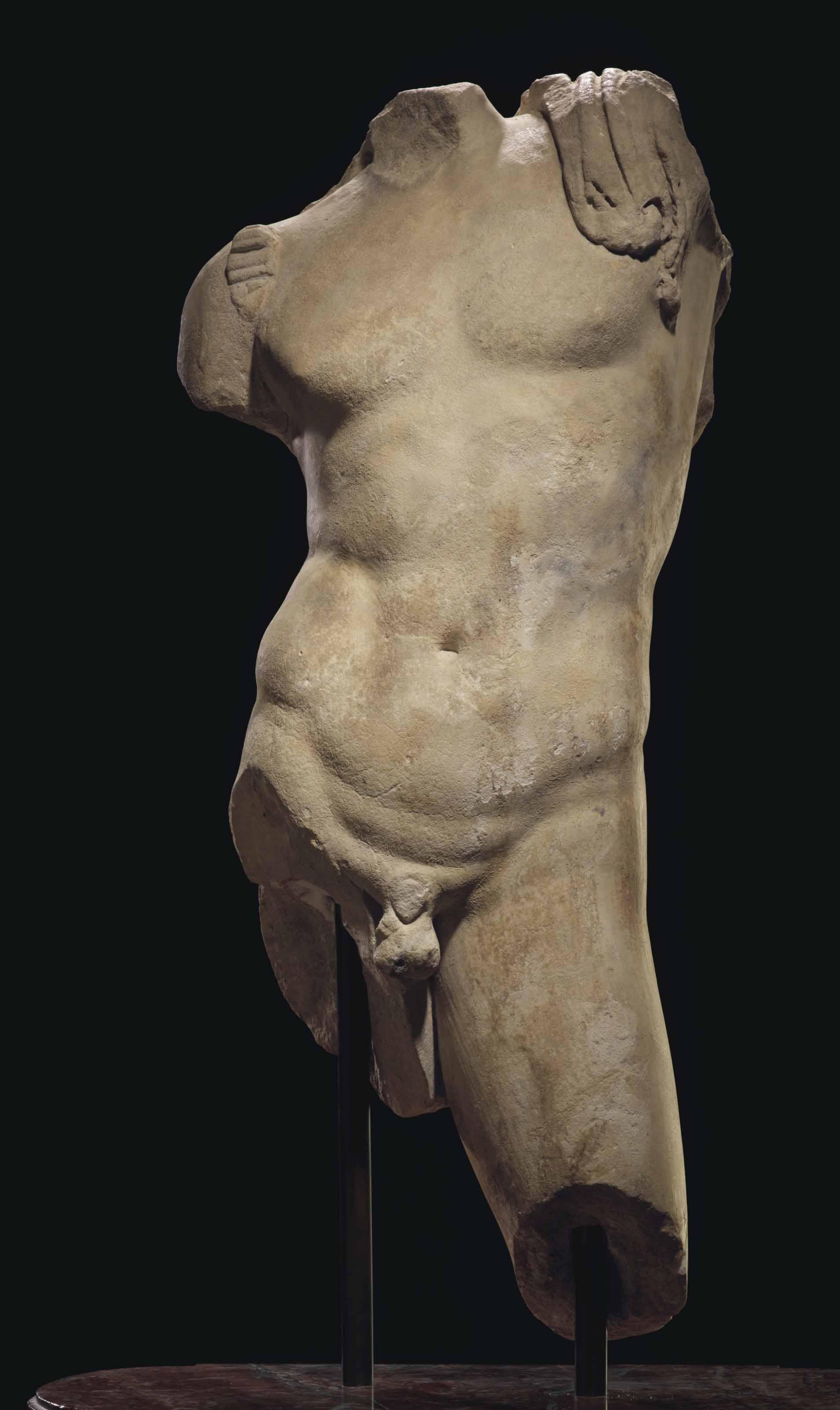 A ROMAN MARBLE TORSO OF BACCHUS