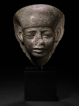 AN EGYPTIAN GRANODIORITE FEMALE HEAD