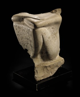 AN EGYPTIAN LIMESTONE BLOCK STATUE OF SENBEF