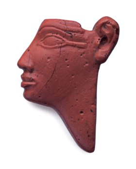 AN EGYPTIAN RED GLASS ROYAL HEAD INLAY