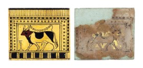 AN EGYPTIAN PAINTED AND GILT GLASS PLAQUE WITH A SACRED BULL