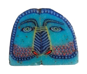 AN EGYPTIAN MOSAIC GLASS OWL INLAY