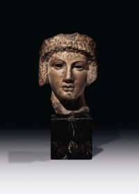 A ROMAN MARBLE ARCHAISTIC HEAD